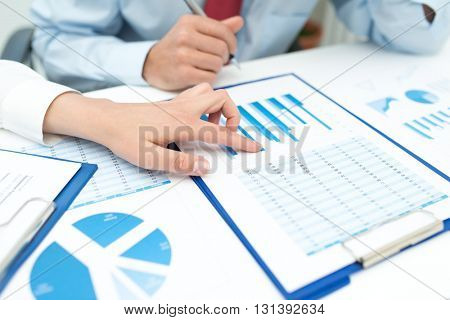 Business people at work on a document