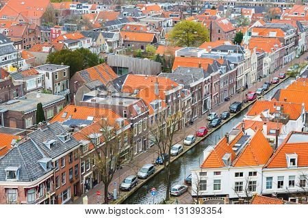 Delft, Netherlands - April 8, 2016: Aerial panoramic downtown street view with houses in Delft, Holland