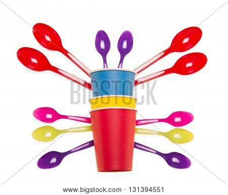 Bright disposable cups and spoons isolated on white background.