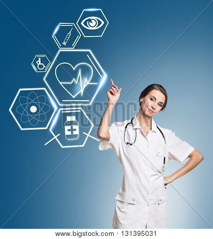 Female medical doctor working with healthcare icons. Modern medical technologies concept