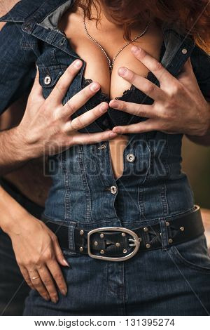 Passion couple embracing. Boyfriend undressing his girlfriend