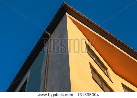 Yellow Walls Under Deep Blue Sky