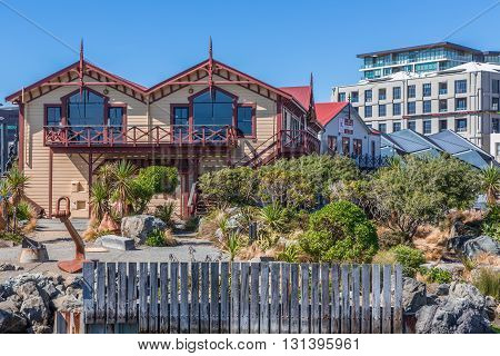 Wellington, New Zealand, February 13 2016 - Wellington waterfront lagoon historic boat sheds (Star Boating Club 1885 and Wellington Rowing Club 1894)