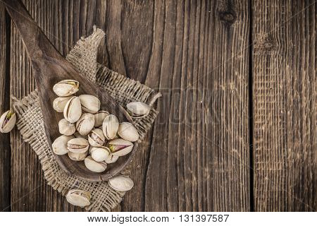 Whole Pistachios On Wood
