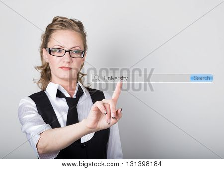 University written in search bar on virtual screen. Internet technologies in business and home. woman in business suit and tie, presses a finger on a virtual scree.