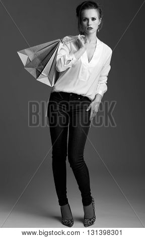 Full Length Portrait Of Modern Elegant Woman With Shopping Bags