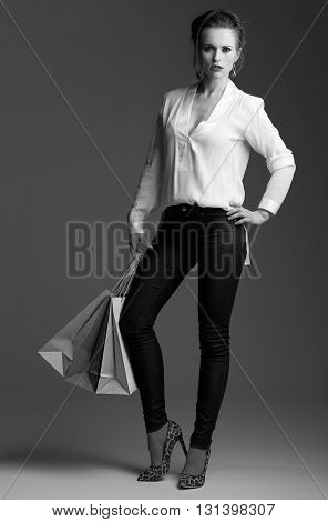 Modern Elegant Woman With Shopping Bags Against Grey Background