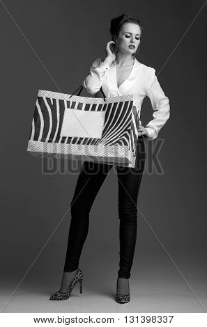 Elegant Woman With Big Shopping Bags Against Grey Background
