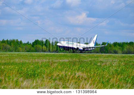 SAINT PETERSBURG RUSSIA - MAY 11 2016. Orenair Airlines Boeing 737-800 airplane-registration number VO-BCJ- is landing on the runway in Pulkovo International airport
