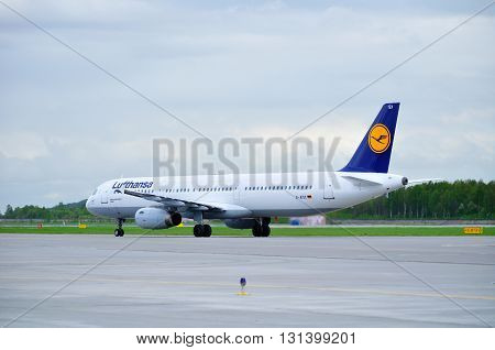 SAINT PETERSBURG RUSSIA - MAY 11 2016. Lufthansa Airbus A321 airplane -registration number D-AISX- rides on the runway after arrival in Pulkovo International airport