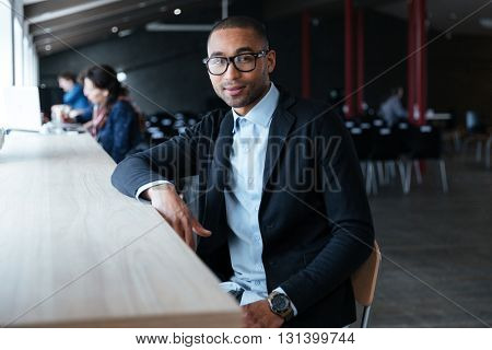 Smiling businessman sitting at his working place