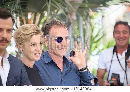 CANNES, FRANCE - MAY 21: Anne Consigny and Charles Berling attend the 'Elle' Photocall during the 69th annual Cannes Film Festival at the Palais des Festivals on May 21, 2016 in Cannes, France.