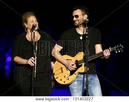 KISSIMMEE, FL-MAR 20: Singer Eric Church (R) performs onstage at the Runaway Country Music Fest at Osceola Heritage Park on March 20, 2016 in Kissimmee, Florida.
