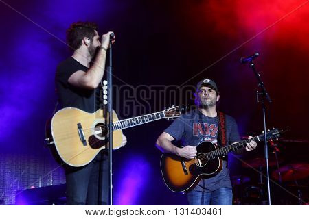 KISSIMMEE, FL-MAR 19: Singer Thomas Rhett (L) and his father Rhett Akins perform onstage at the Runaway Country Music Fest at Osceola Heritage Park on March 19, 2016 in Kissimmee, Florida.