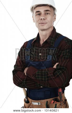 Muscular professional man in a builder uniform with tools.