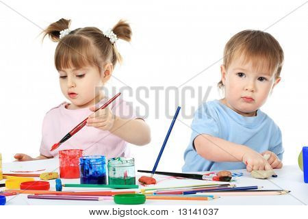Beautiful child enjoying his game. Shot in a studio.