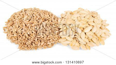 Pumpkin seeds and sunflower isolated on white background.