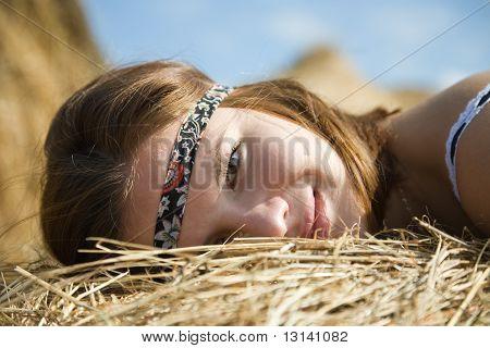 Girl Laying On Straw