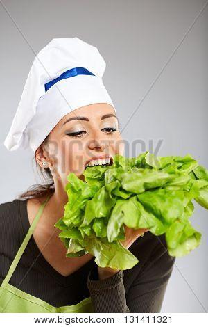 Woman Cook Biting Lettuce