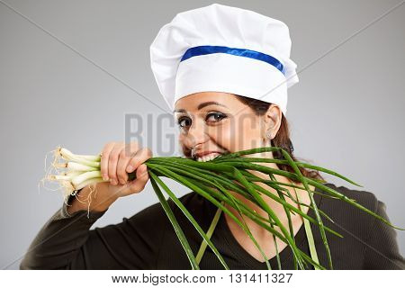 Woman Cook Biting Spring Onions