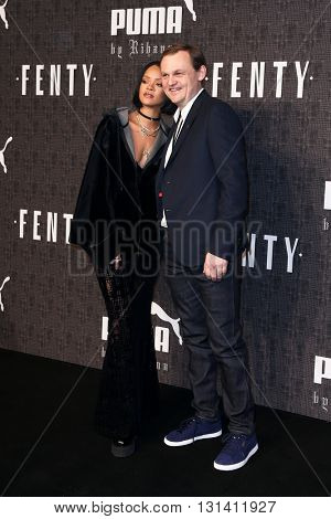 NEW YORK-FEB 12: Recording artist Rihanna (L) and Puma CEO Bjorn Gulden attend the FENTY PUMA by Rihanna AW16 Collection during Fall 2016 New York Fashion Week on February 12, 2016 in New York City.