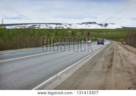 Road in Murmansk region Russia. Early spring