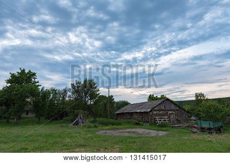 Country yard with horse cart and clouds
