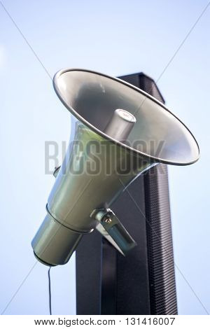 Simple audio system make of megaphone and speaker.