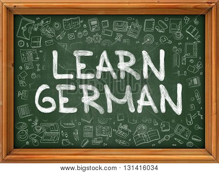 Learn German Concept. Modern Line Style Illustration. Learn German Handwritten on Green Chalkboard with Doodle Icons Around. Doodle Design Style of  Learn German Concept.