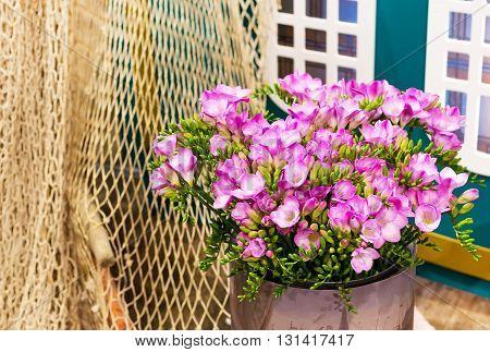 Vibrant flower close-up bouquet of pink alstroemeria background still-life with fishing net