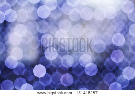 Blurring lights bokeh background of blue circles