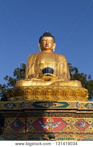 Kathmandu, Nepal - October 20, 2014: Big Golden statue in Amideva Buddha Park