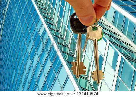 The keys to the office on the background of a skyscraper