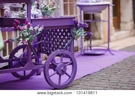 Lavender wagon near the flower boutique in the town of Garda Italy