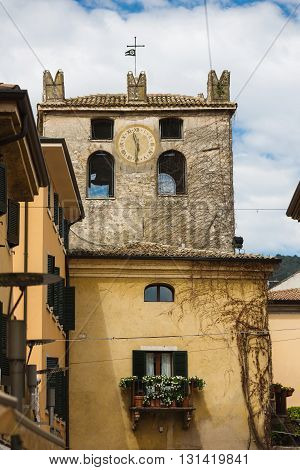 The clock tower in the old town of Garda Italy