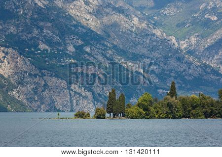 Peninsula on the Lake Garda with Dolomite mountains on the background