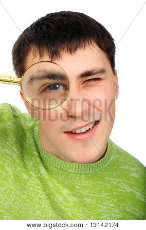 Portrat of a young man looking through the magnifying glass