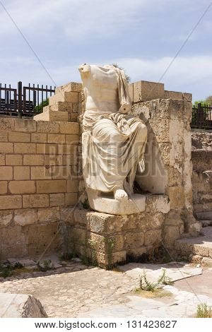 Partially Preserved Statue Of White Marble In The Ruined City Of Caesarea