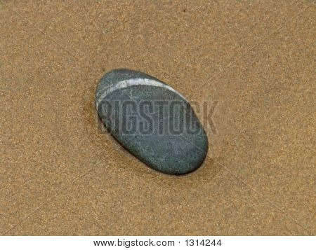 Pebble On The Sand