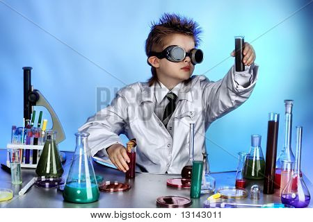 Educational theme: funny teen, medicine, science. Shot in a studio.