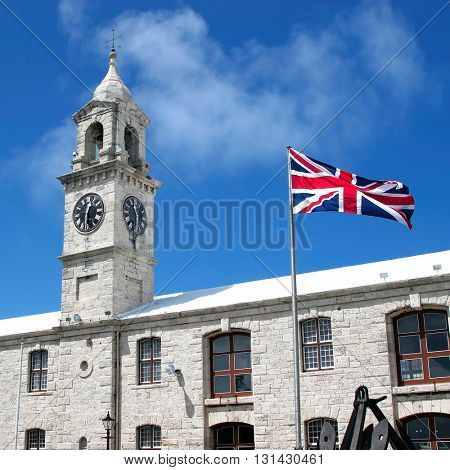 The Clocktower and the Union Jack flying in the Royal Naval Dockyards, Bermuda.