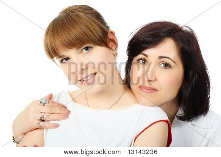Portrait of a happy mother with her grown-up daughter. Shot in a studio.