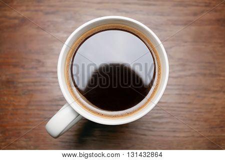Vintage dark wood background black coffee in a mug.