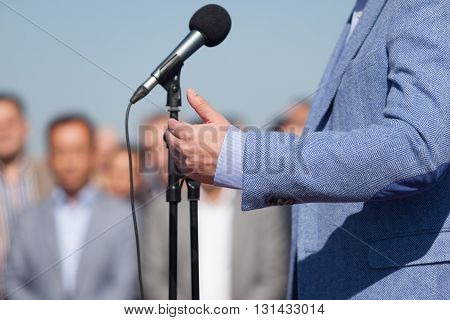 Speaker. Speech. Microphone. News Conference. Politician or businessman speech.