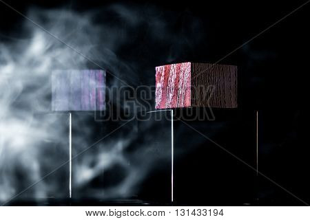 the jar of perfume on a background of smoke black background