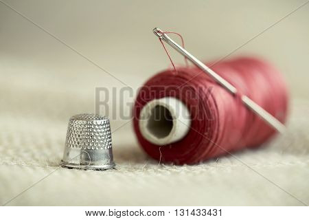 Handmade concept - old retro needle thread and thimble