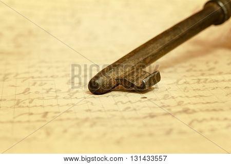Old key on a letter - vintage background