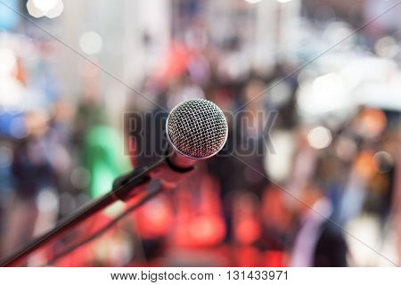 Microphone in focus against blurred background. Press conference.