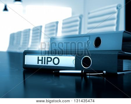 HiPo - Business Concept on Toned Background. HiPo - Ring Binder on Wooden Desktop. Binder with Inscription HiPo on Black Wooden Desk. 3D Render.