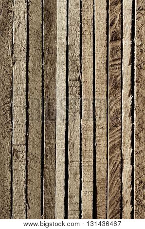 Variegated Natural Colored Background of Cracked Wooden Plank closeup. Sepia Toned